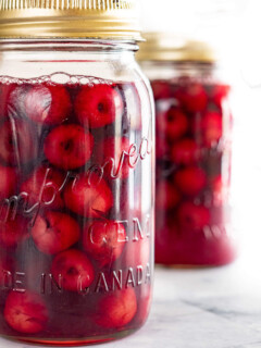Two jars of canned cherries.
