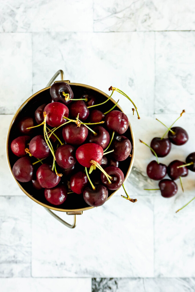 Cherries in a metal bucket.