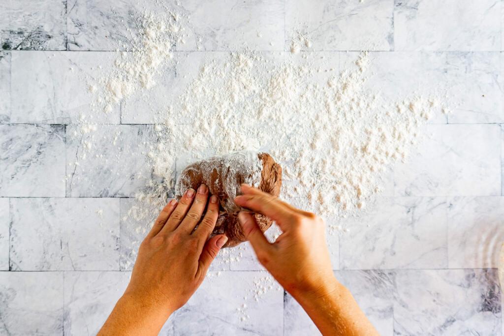 Shaping the dough into a boule.