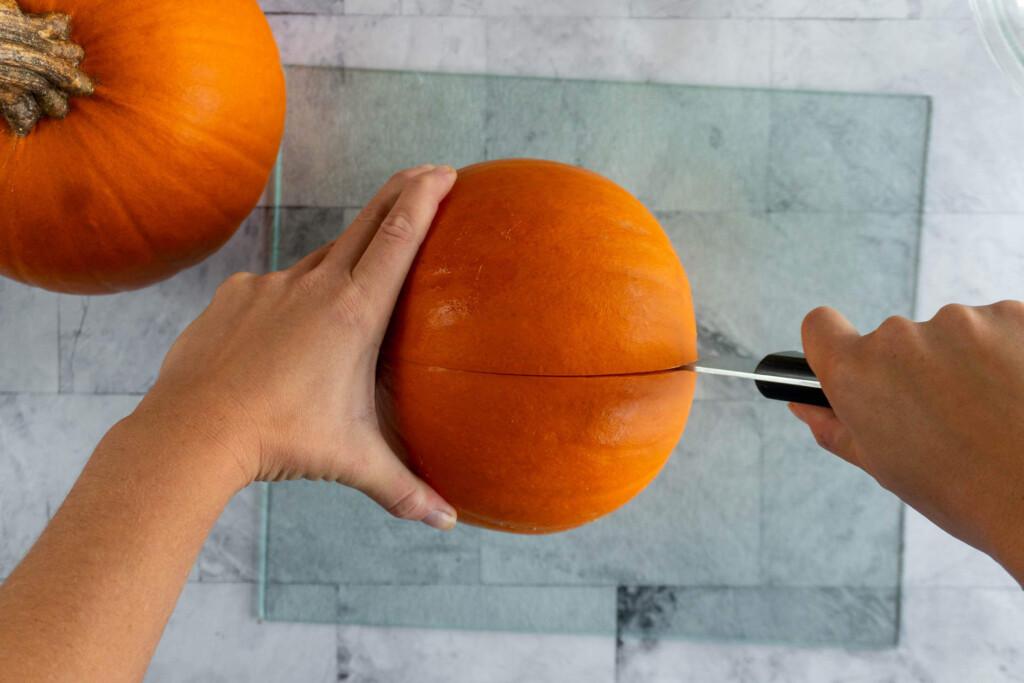 Cutting the pumpkin.