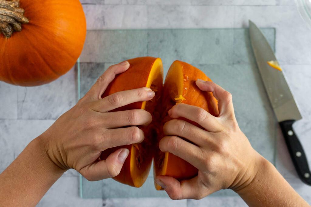 Prying the pumpkin apart.