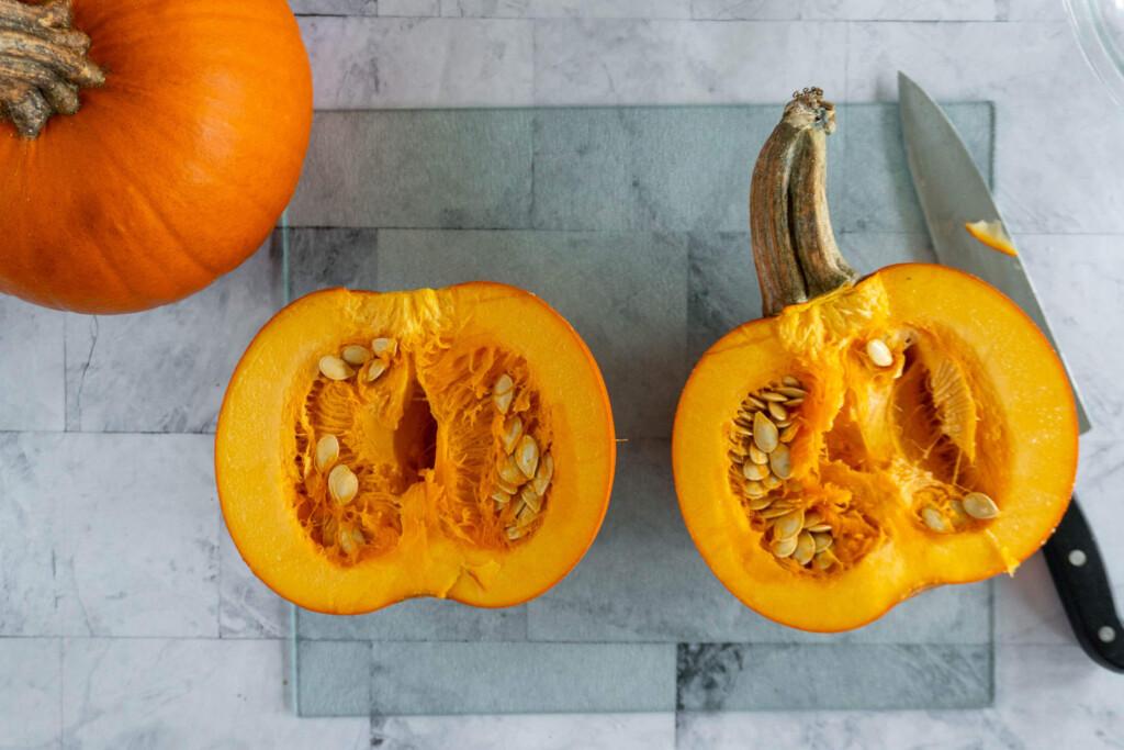A sugar pumpkin cut in half.