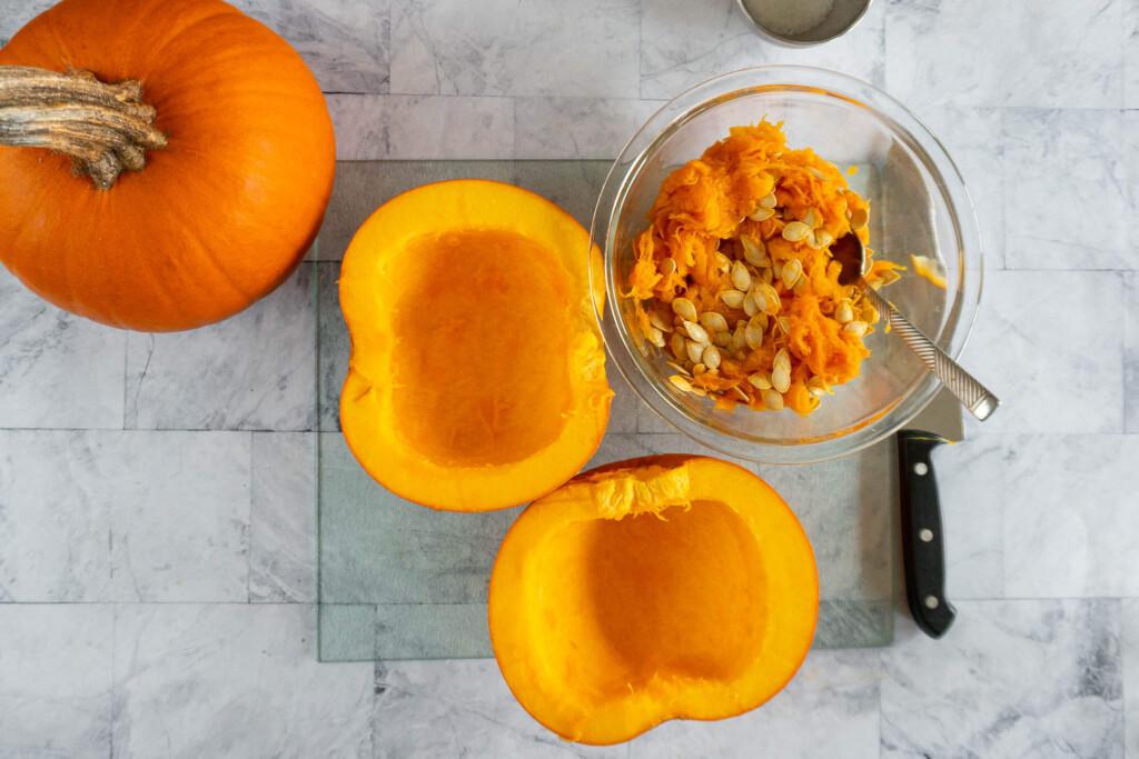 Two hollowed pumpkin halves.