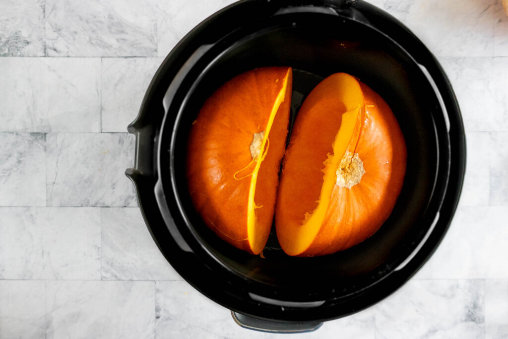 Two pumpkin halves in an instant pot.