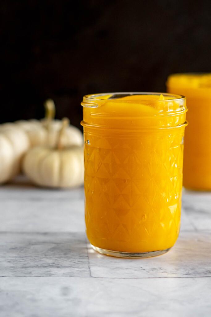 Homemade pumpkin puree in a mason jar.