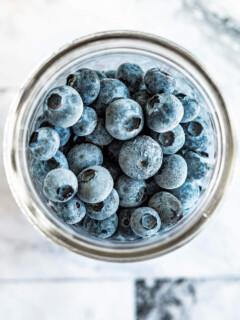 Frozen blueberries in a mason jar.