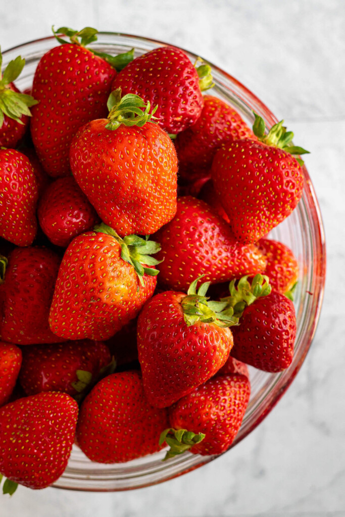 A bowl filled with bright red strawberries.