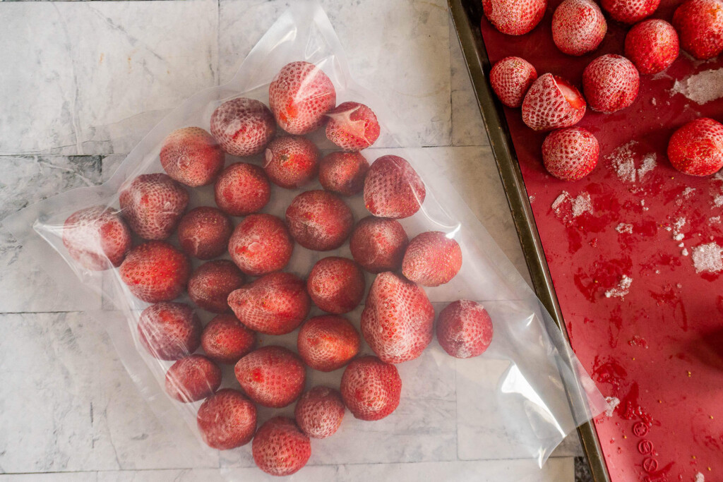 A vac seal bag full of frozen strawberries.
