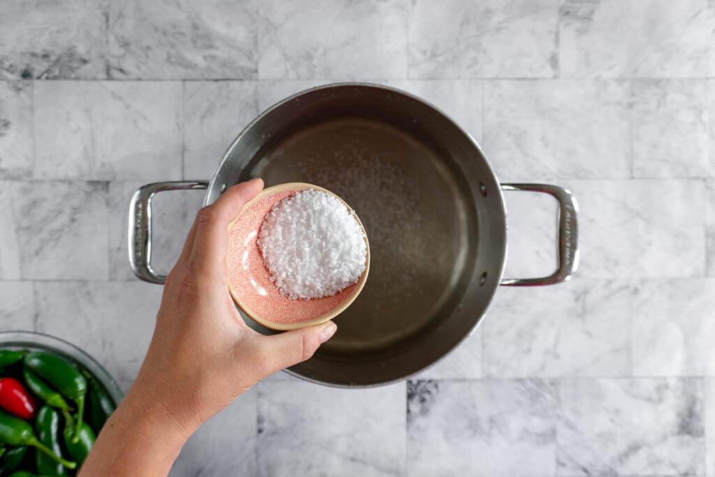Adding salt to brine.