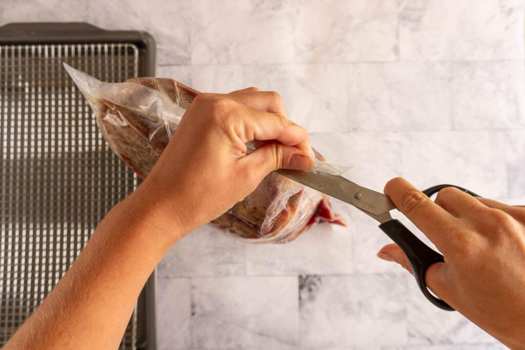 Opening the sous vide bag.