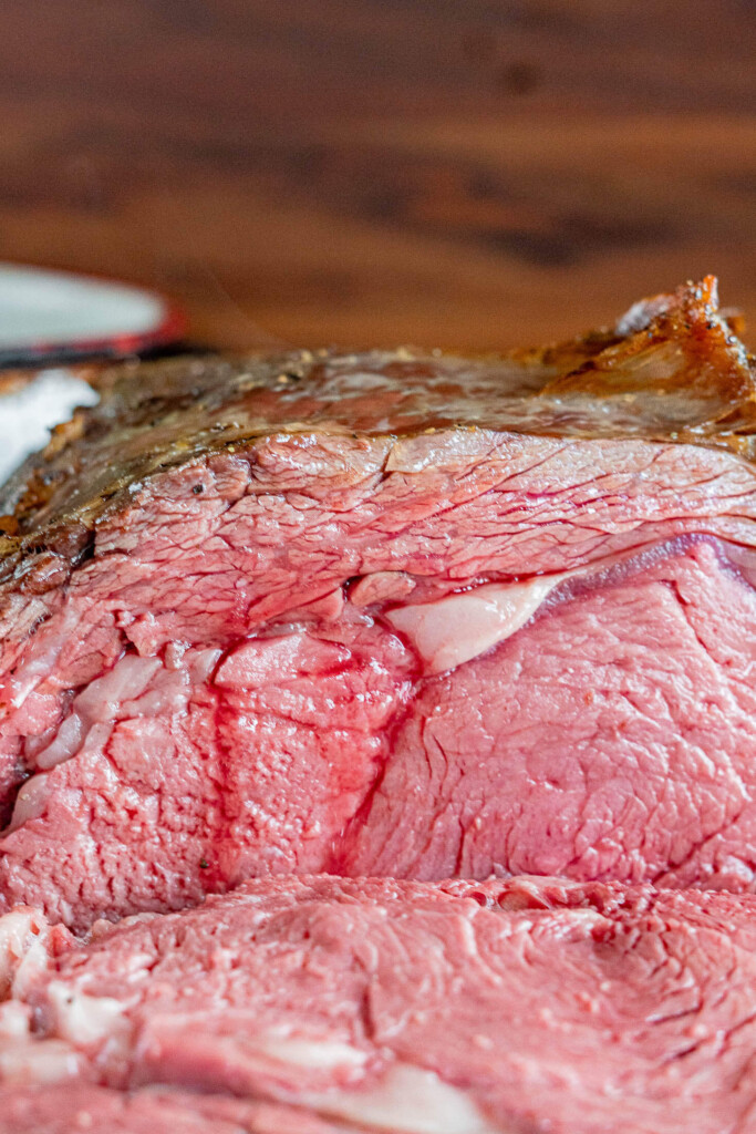 Juices running from the sliced prime rib.
