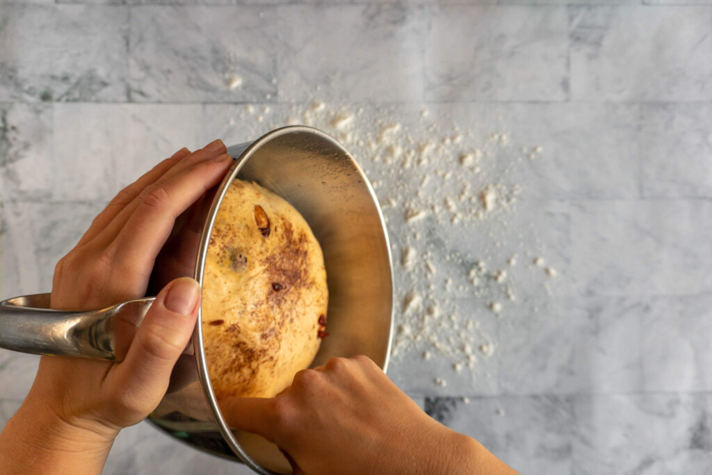 Turning the dough onto a floured surface.