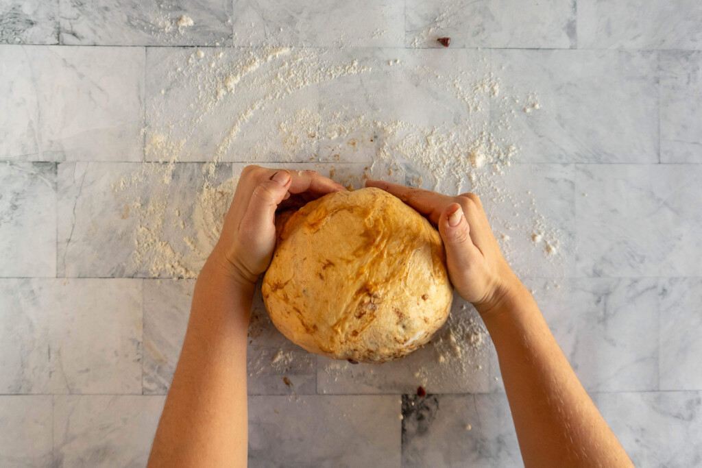 Forming the dough into a boule.