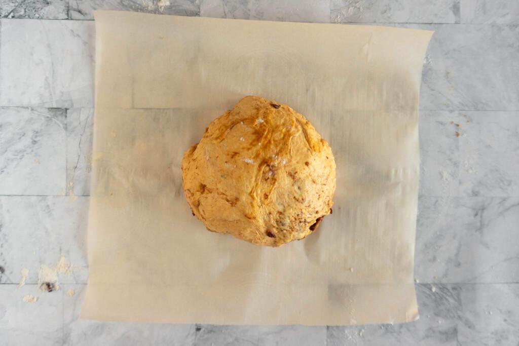 Dough seam side down on a parchment paper.