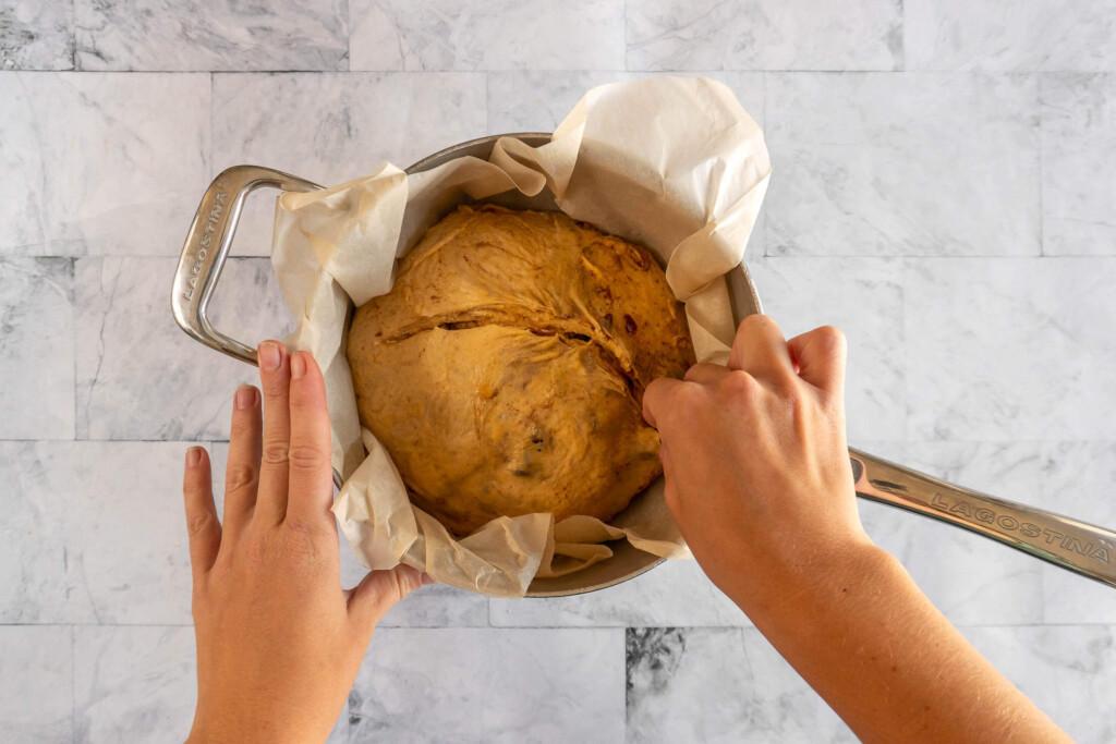 Scoring the pumpkin sourdough bread.