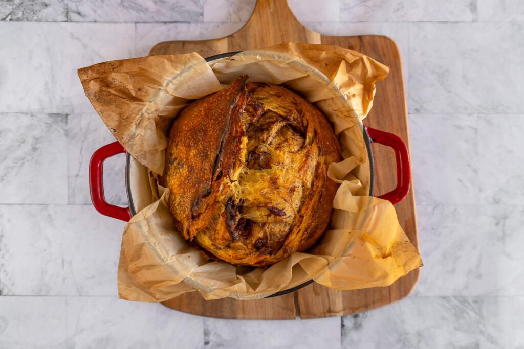 Baked pumpkin sourdough in a dutch oven.