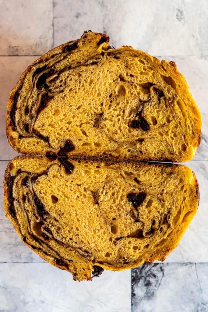 Two halves of a pumpkin sourdough loaf.